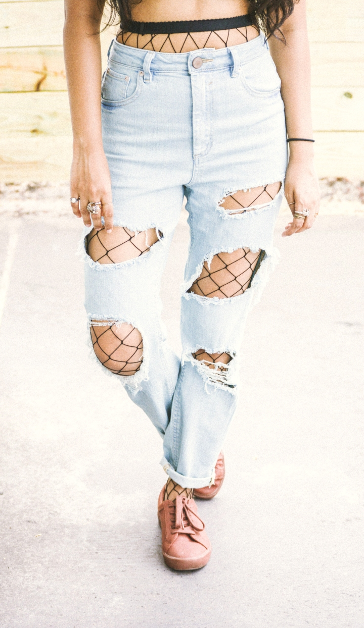 fishnet stockings under mom jeans rust shoes