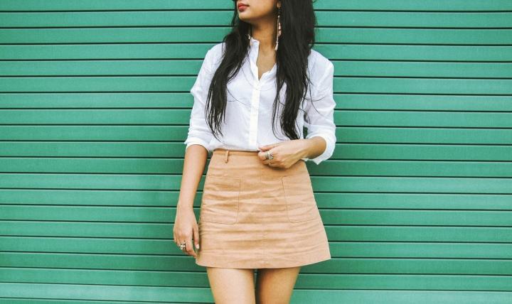 white shirt and tan skirt white converse