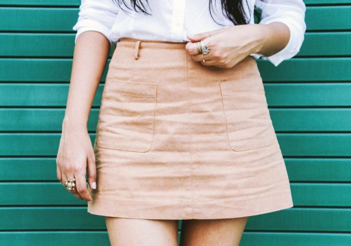 tan skirt white shirt rings closeup